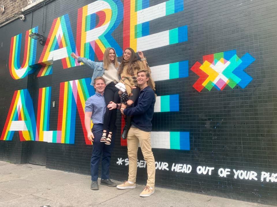 CAPAStudyAbroad_Summer2019_Dublin_Katie Berlin_Sara, Daniel, Michael, and I in front of Dublin mural
